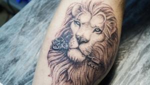 Обзор тату в виде льва для мужчин и их расположение